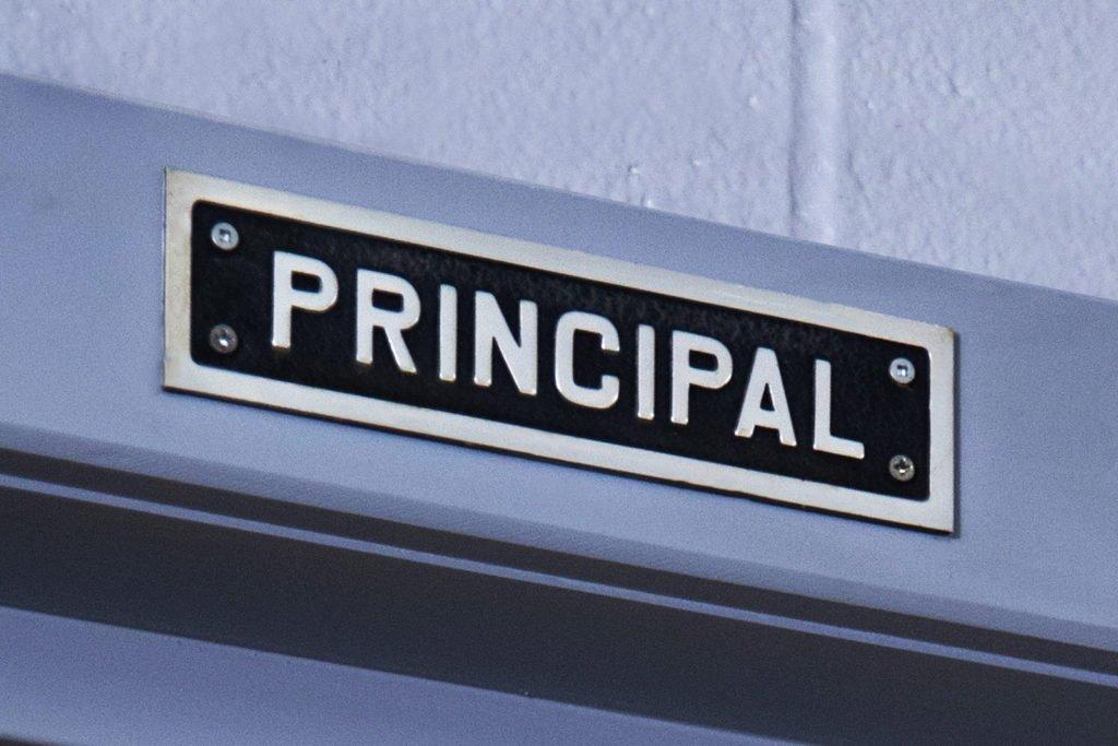 Principal plaque on door frame